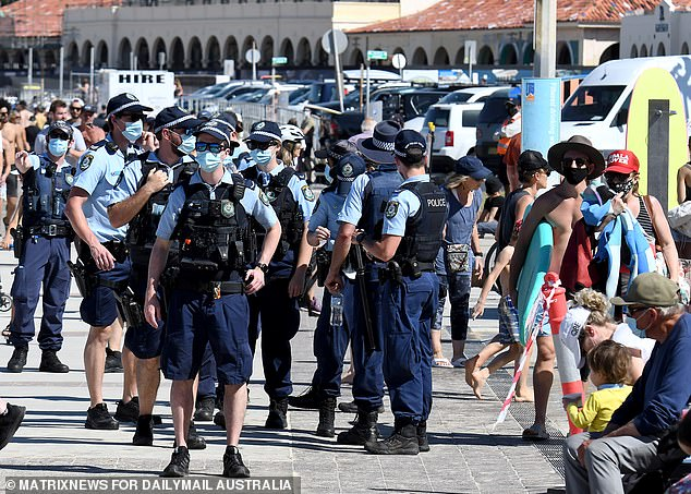 Police were still out in force in Bondi (pictured) cautioning sunbakers who weren't socially distancing or wearing a face mask