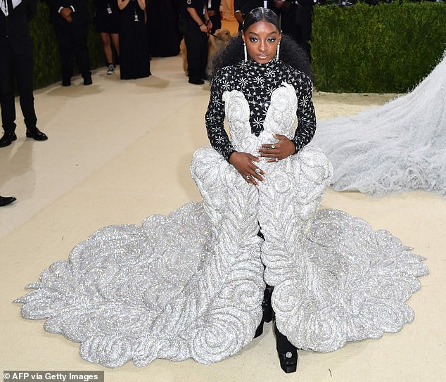 Stunning in silver: Simone Biles made quite the splash at the Met Gala on Monday, making her debut at the event in a stunning floor-length gown