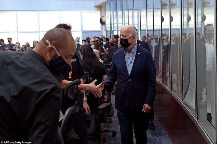 US President Joe Biden greets employees at the California Governor's Office of Emergency Services in Mather, California