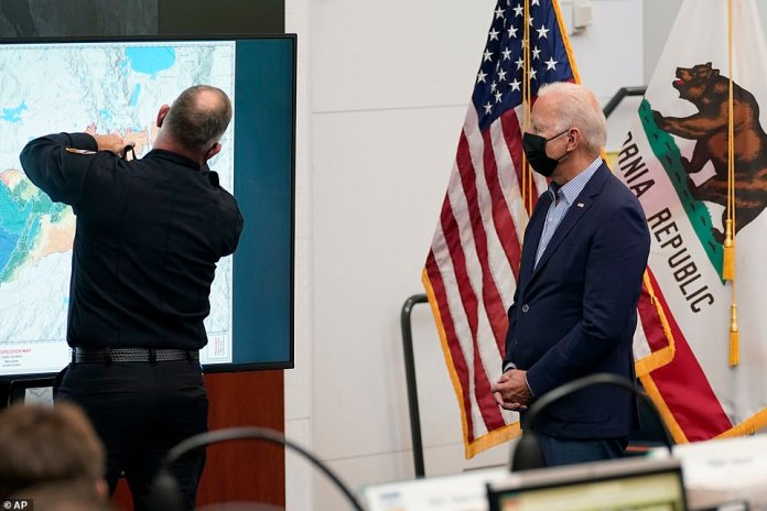President Joe Biden listens during a briefing on wildfires at the California Governor's Office of Emergency Services