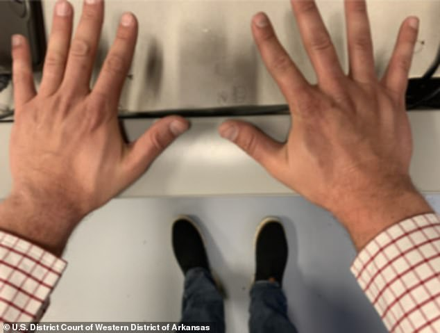 On April 29, 2021 law enforcement took three high angle photographs of Duggar's open hands over his feet while he was in custody