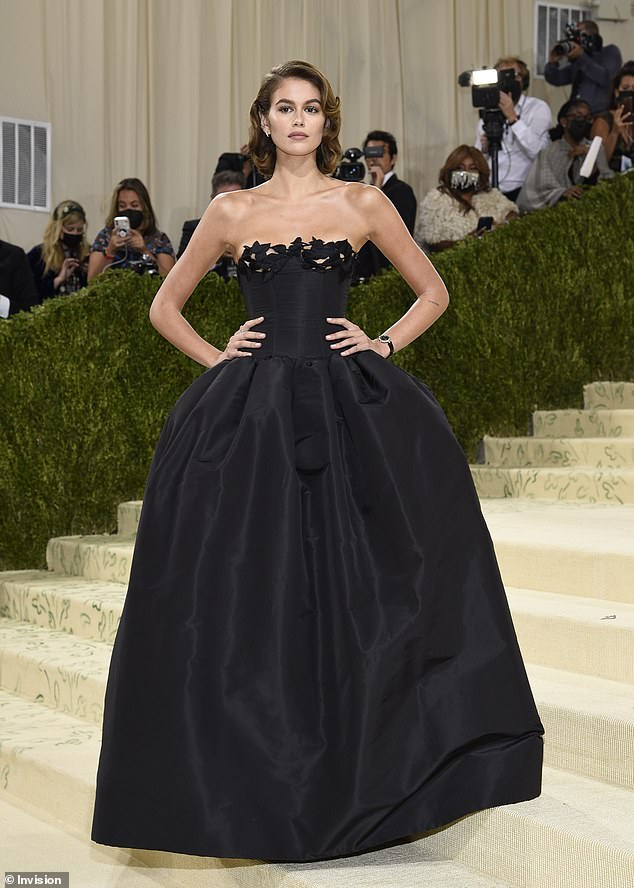 Stunning: The rising star kept up with the theme - which was In America: A Lexicon of Fashion - in the form of nostalgia as she sported an exquisite Oscar de la Renta number