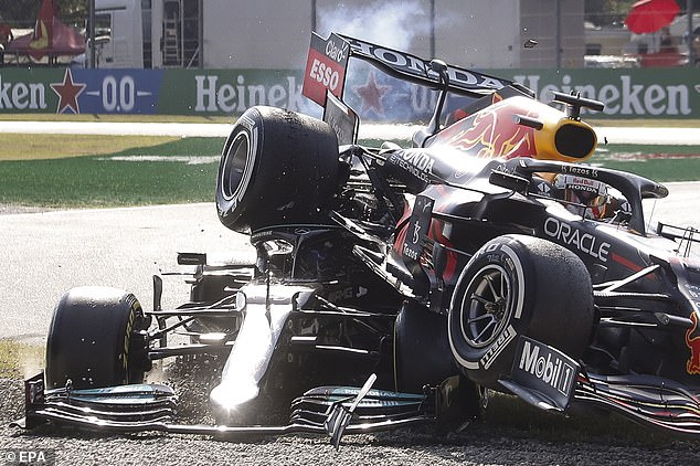 The Red Bull was left nose-first in the gravel trap with the Mercedes wedged underneath