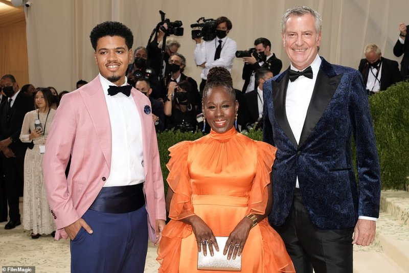 Despite numerous protestors being arrested outside, de Blasio arrived on the red carpet in a velvet blue suit, alongside his wife Chirlane McCray and son Dante