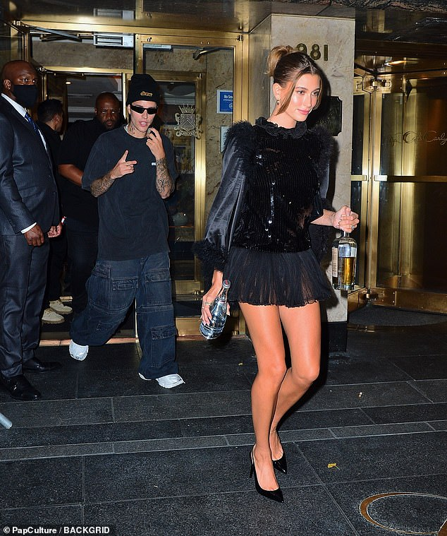 Leggy:Hailey Bieber put on a leggy display as she switched out of her floor-length gown and into a glitzy LBD