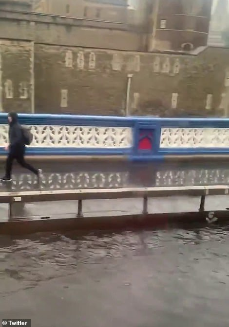 Tower Bridge is flooded after heavy rain in London this morning
