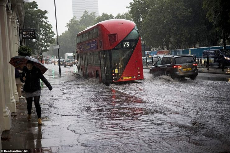 The Met Office's warning means drivers have been urged to take caution on flooded roads. Pictured: Euston Road, London