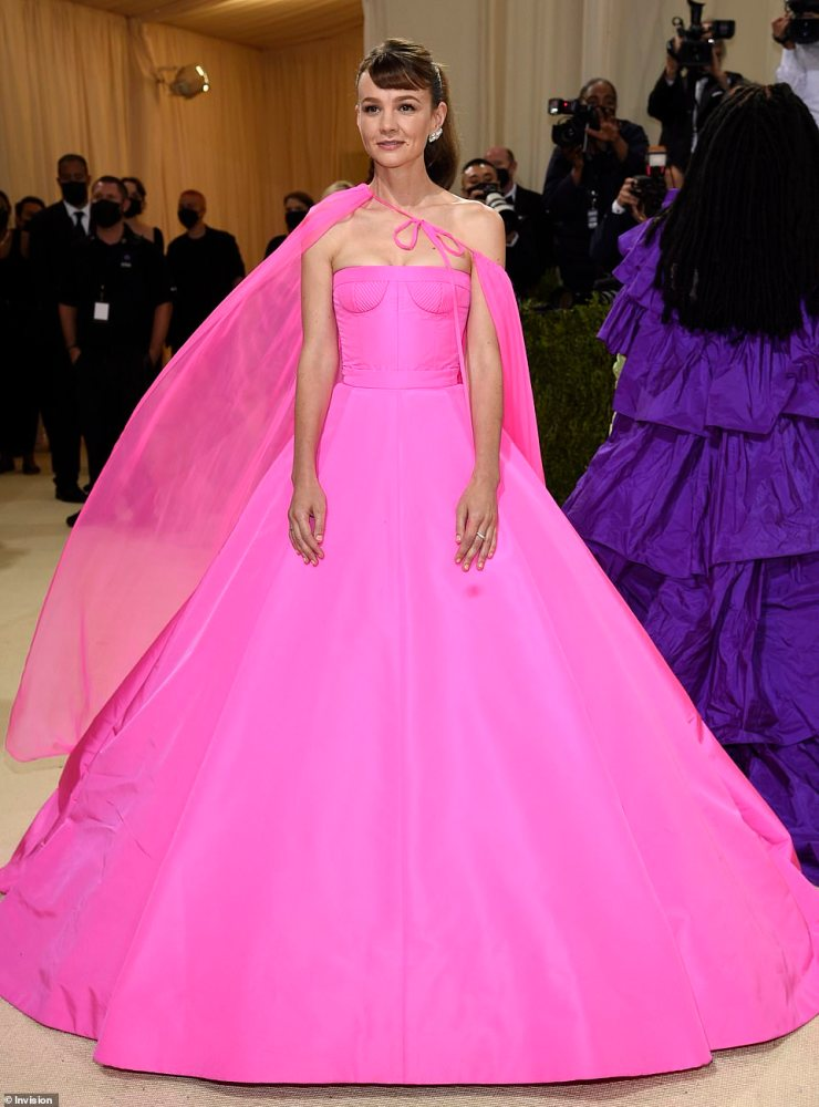 Gorgeous: Carey's petite frame was perfectly shown by her gown's corset-inspired bustier while the elongating cape gave her look the wow factor