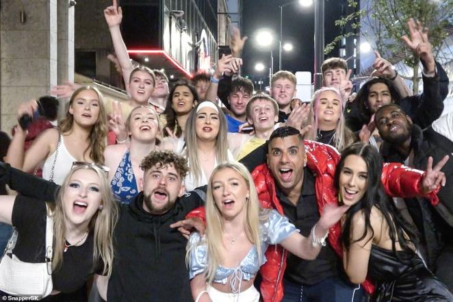 A group of freshers pose for a picture in Birmingham's Broad Street as students returned, without restrictions, to celebrate the start of this year's Freshers' Week