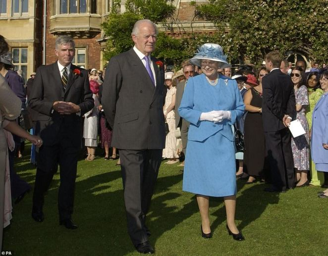 Queen Elizabeth II hosts a garden party at Sandringham House in Norfolk with her friend Sir Timothy Colman in July 2002
