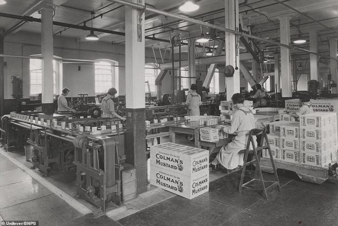 Colman's workers are seen packing mustard tins into boxes during the Second World War at the factory in Norwich in 1940