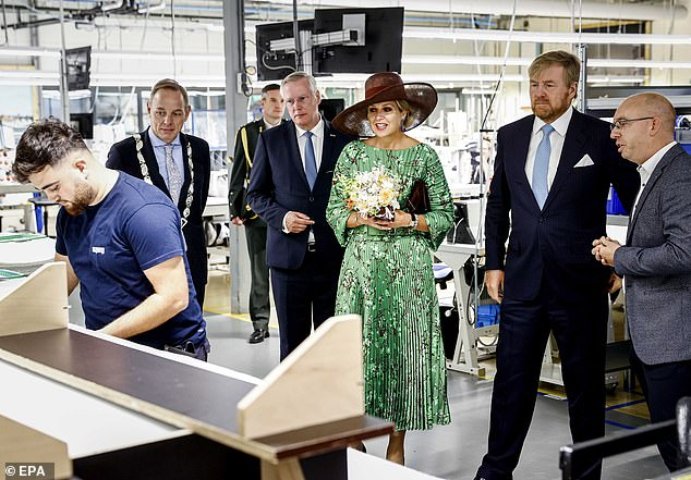 Meanwhile, King Willem-Alexander, 54, opted for a blue pinstripe suit with a crisp white shirt and patterned blue tie.  The couple is pictured in Overijselo looking at a local enterprise in Deventer, in the southern part of the Saalland