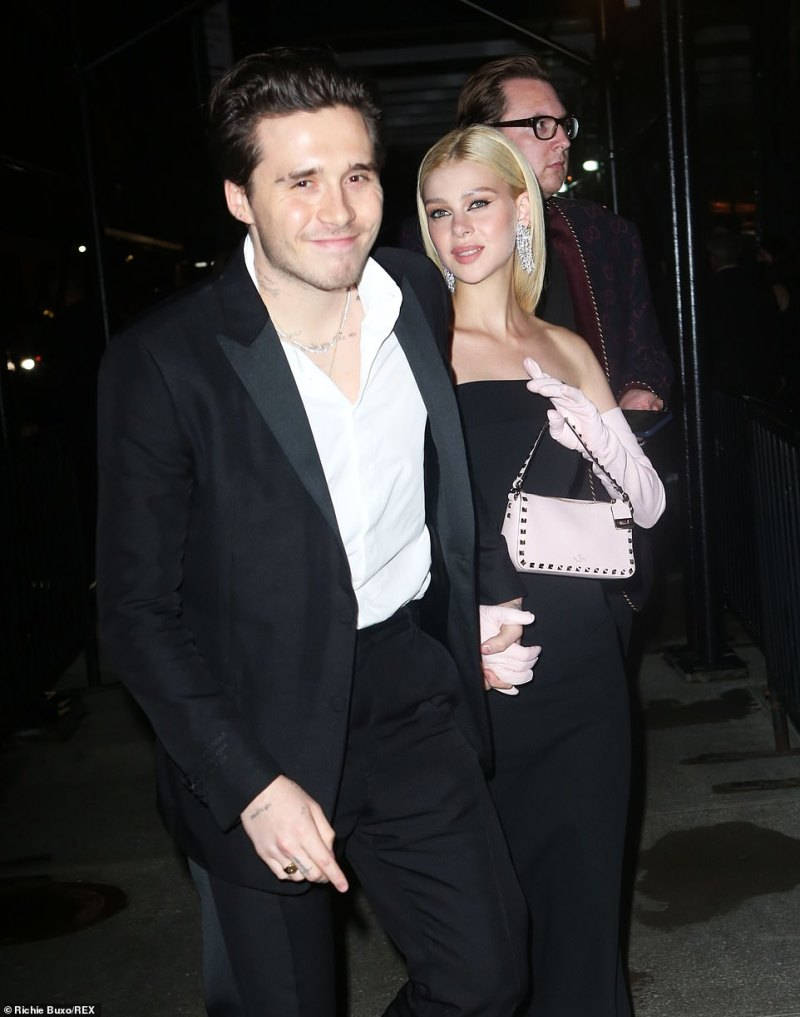Loved-up:Brooklyn Beckham and his fiancée Nicola Peltz put on a loved-up display and held hands