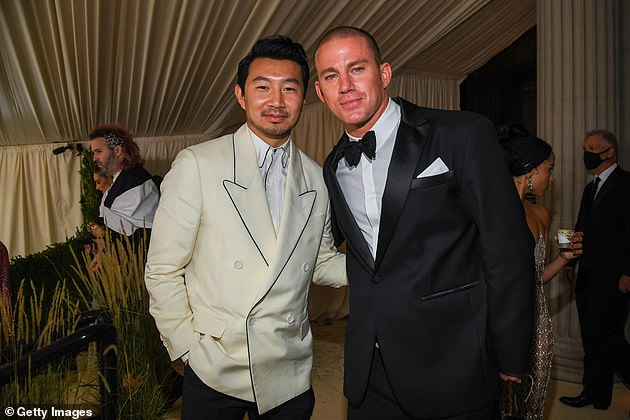 Mingling: Channing posed for a snap withShang-Chi and the Legend of the Ten Rings actor Simu Liu (left) on the way out