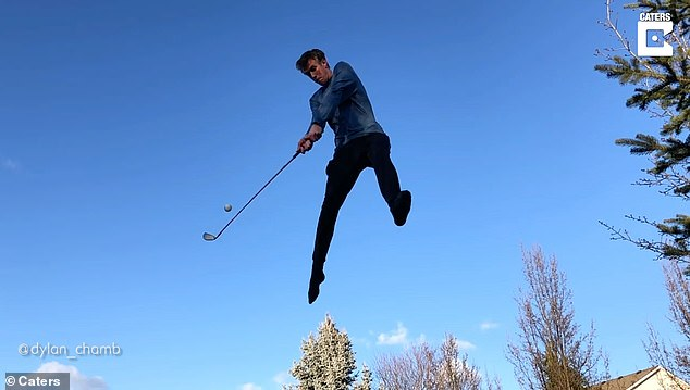 The slow-motion video shows Dylan effortlessly send the golf ball soaring through the air, despite only using a thin golf club to take the difficult trick shot
