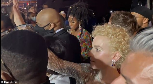 In a video obtained by DailyMail.com, Julia Garner could be seen raising her hand to signal a security guard blocking the entrance to Rhianna's after party of the Met Gala on Monday