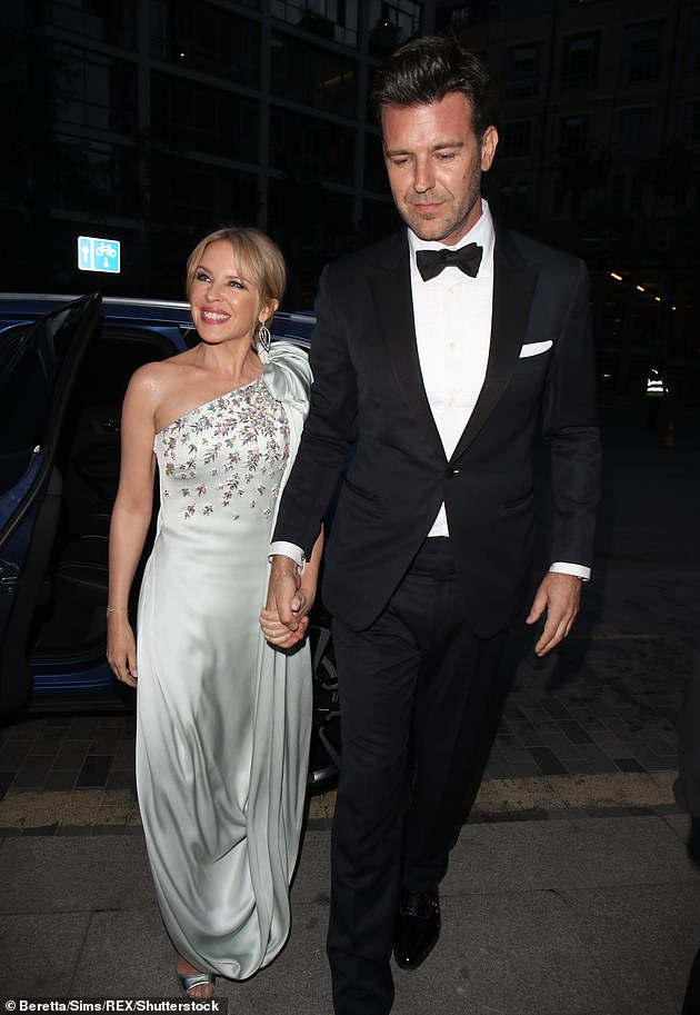 Ready to wed:It's also been a happy ending for Kylie, whose engagement to Paul Solomons (right) was confirmed in February. She has been dating GQ boss Paul, 46, since 2018