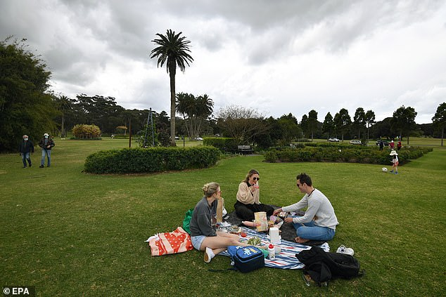 There is a push forsuburbs with low case numbers removed from the list of hotspots, which are subject to heightened restrictions in NSW (pictured, residents enjoying eased restrictions in Sydney)