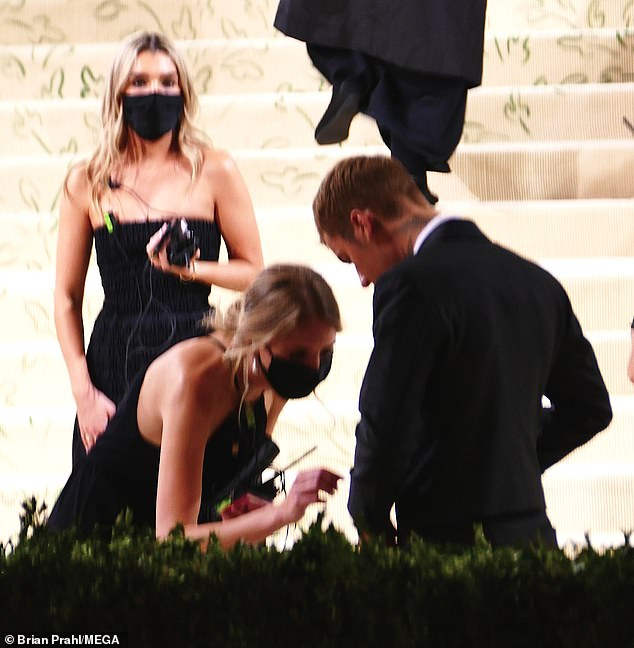 Quick fix: At one point, Justin was also offered some help adjusting his suit before snapping a few more photos