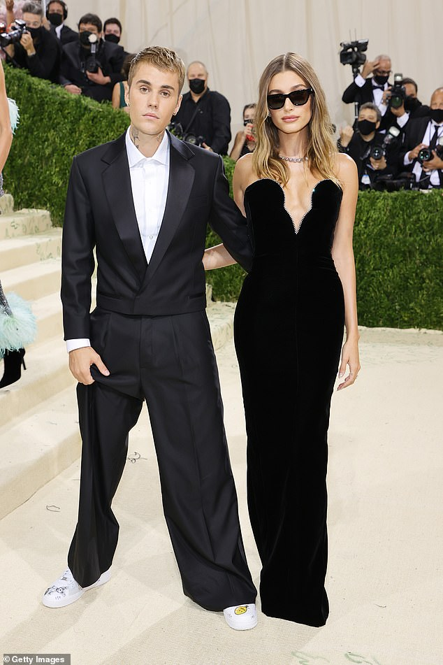 Beautiful: Hailey simply stunned in a black strapless Yves Saint Laurent gown which featured a sparkling plunging neckline