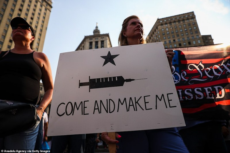 A protester in New York City on Monday holds a sign that reads 'Come and make me'