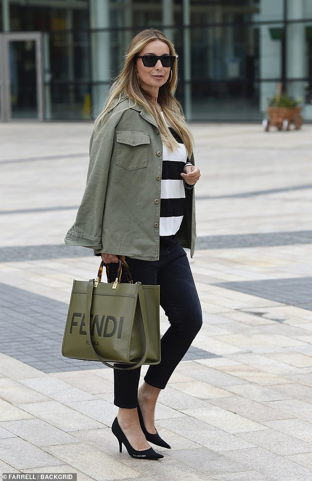 Designer: The star oozed confidence as she made her way home while sported a green designer Fendi handbag