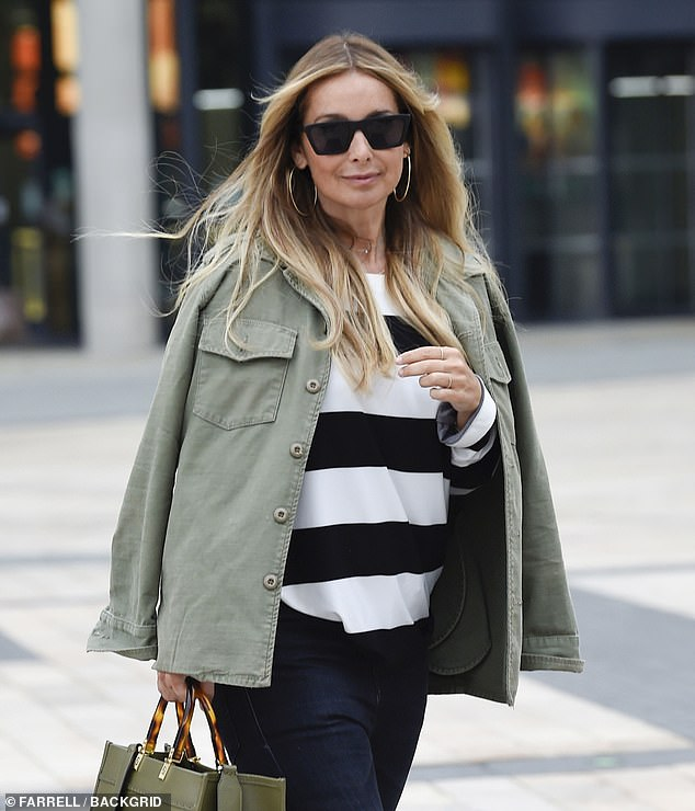 Style: The former Eternal singer, 46, looked incredible in a stylish khaki shirt jacket and black Balenciaga heels