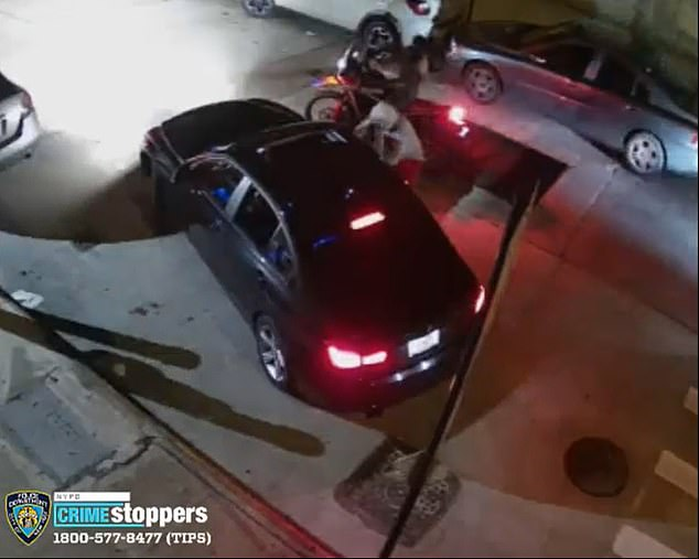 A pair of motorcyclists stop a 23-year-old driver from leaving his parking spot as one them, pictured in a grey hoodie, pulls out a gun and points it at the driver