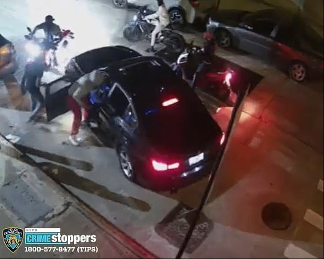 A whole gang appears to trap the driver in place and they begin pulling him out of the car