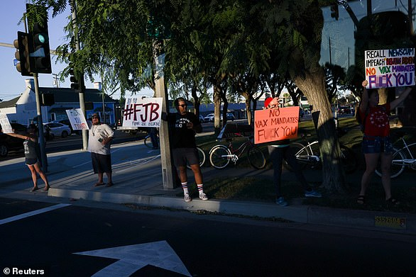 Protesters greeted President Joe Biden and California Gov. Gavin Newsom with profane signs in Long Beach on Monday night