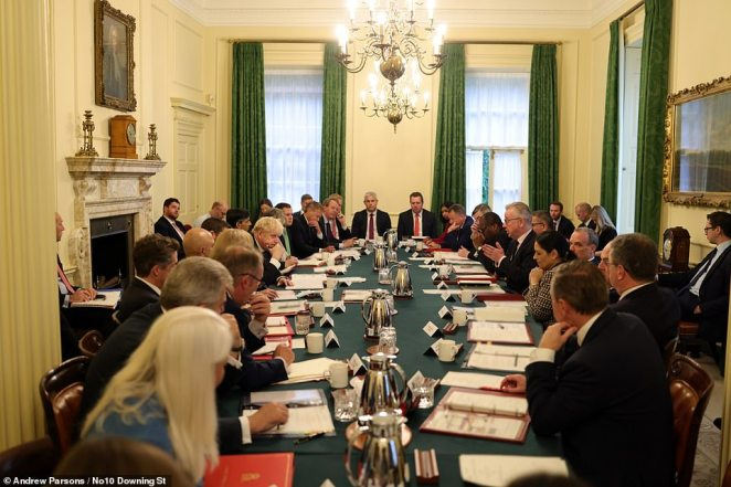 Ministers were packed in the Cabinet room this morning with no masks as they were briefed on the contents of the plan