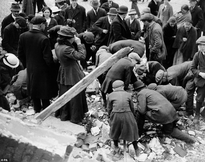 The uprising had been timed to take advantage of the fact that the British Government and Army were then focused on fighting in the First World War, with military chiefs preparing to launch the Battle of the Somme. Above: Souvenir hunters look among the rubble of buildings destroyed during the Easter Rising