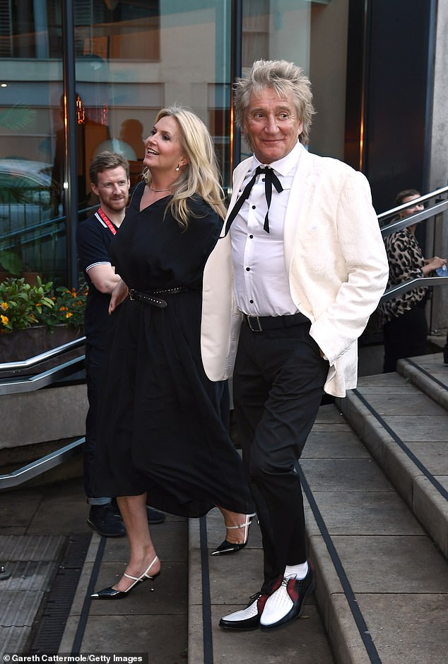 Stepping out:He stepped out in a pair of unique white, brown and black tap-shoe-style dress shoes, smiling for pictures