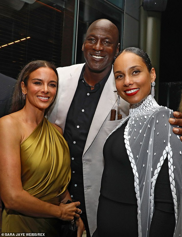 Have a ball!  The singer was always the attentive host when she met Michael Jordan and his wife Yvette Prieto