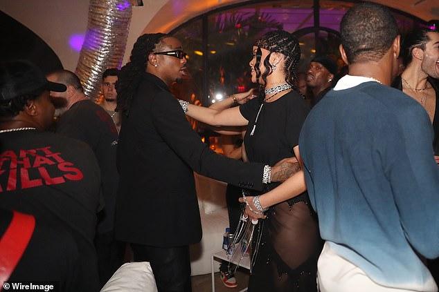 Hugs! The hostess was seen greeting Migos rapper Quavo