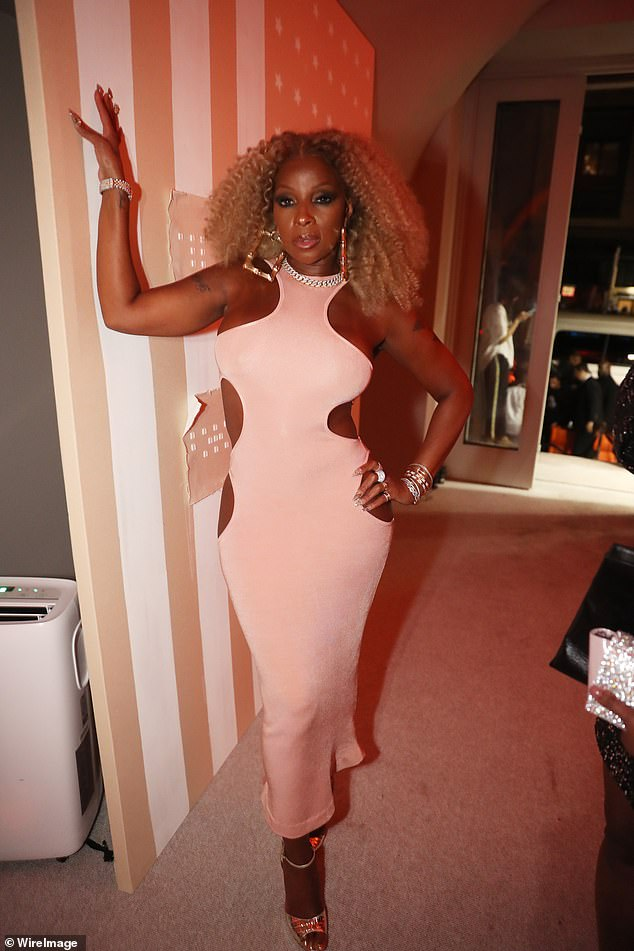 Glam:Legendary singer Mary J. Blige was spotted at the event in a slinky blush bodycon dress with cutouts at her waist and hips