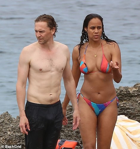 PICTURE EXCLUSIVE: Shirtless Tom Hiddleston packed on the PDA with bikini-clad girlfriend Zawe Ashton as they enjoyed a romantic beach day on Monday while holidaying in Ibiza