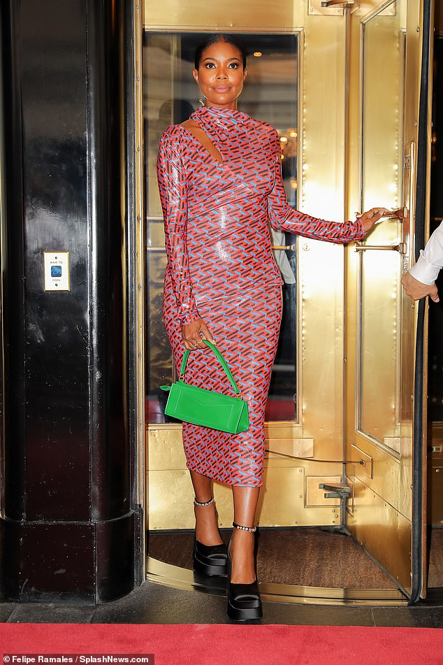 Chic: Flawless co-founder Gabrielle Union stepped out of The Carlyle on Manhattan's Upper East Side on Tuesday, gorgeous in a patterned PVC pencil dress, black platforms and a green bag