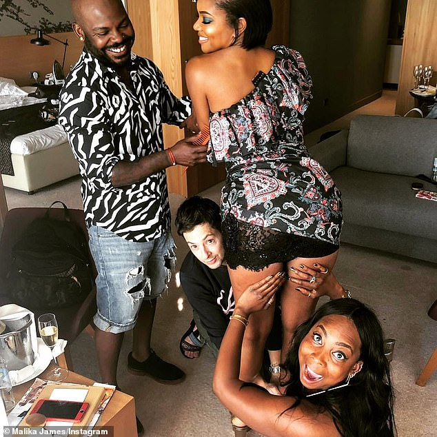 Ouch!  But everything took a dark turn when Union and her glam team (from LR, pictured in 2019) - hairstylist Larry Sims, stylist Thomas Christos Kikis and makeup artist Malika James - decided to visit a local bar with memorabilia from ' Jim Crow and neo-Nazi patrons'