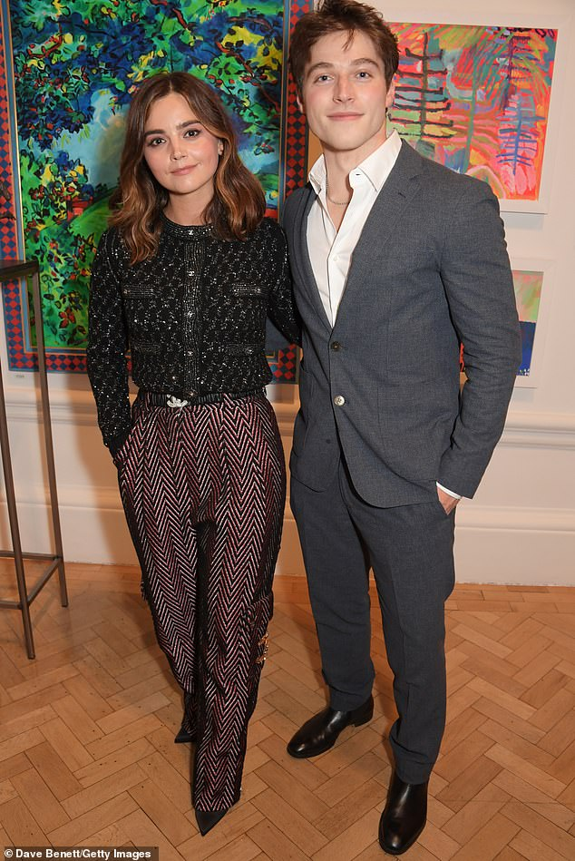 Famous friends: Jenna posed with American actor Froy Gutierrez, 23, with the Teen Wolf star wearing a grey suit and white shirt which he left unbuttoned at the collar