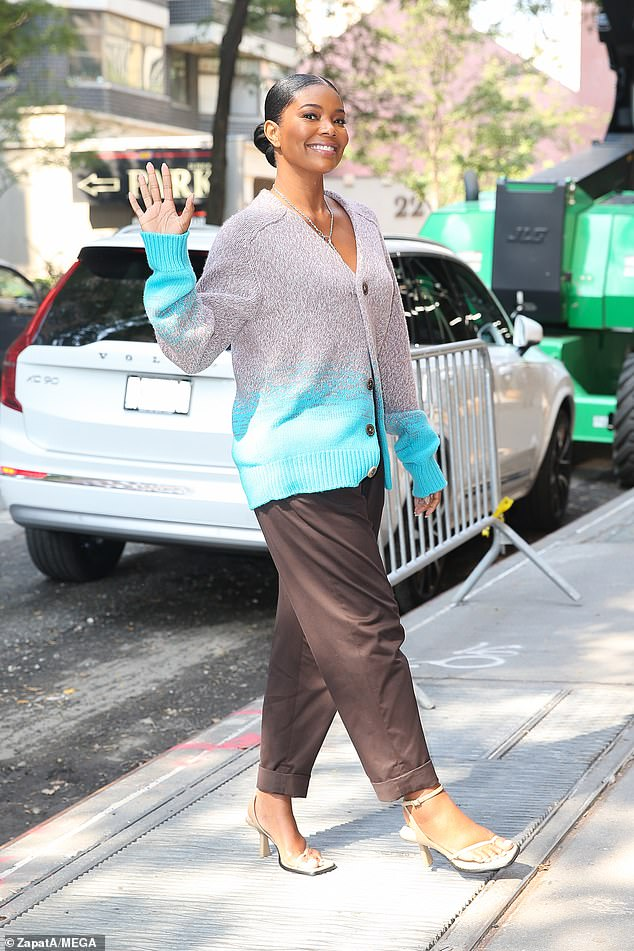 The morning sun!  Earlier on Tuesday, the New York & Company collaborator looked comfy in a gray and blue cardigan as he walked back inside the Carlyle, A Rosewood Hotel