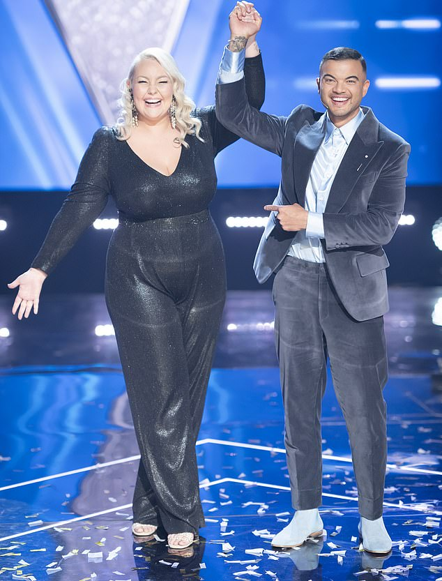Champion: Bella, 23, who is a member of the evangelical megachurch, was crowned the winner of The Voice on Sunday night after her impressive performance of Andrea Bocelli's The Prayer alongside her coach Guy Sebastian (right), a devout Christian with links to Hillsong