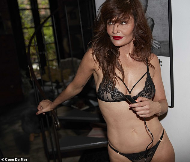 Stunning:The Danish beauty highlighted her jaw-dropping figure as she posed in a black sheer two-piece while posing in front of a window