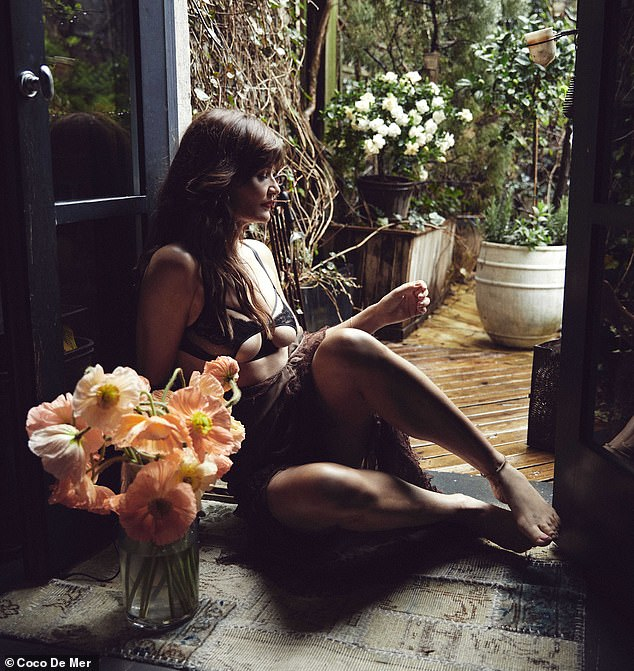 Incredible: Helena sat on the floor by the door for another image, gazing out into the rainy afternoon, a vase of stunning flowers next to her