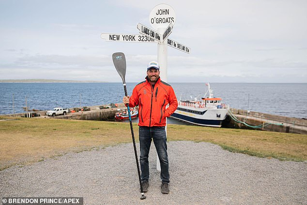 Thesea safety campaigner set two world records and broke a third yesterday after he finished paddleboarding the entire British mainland coast