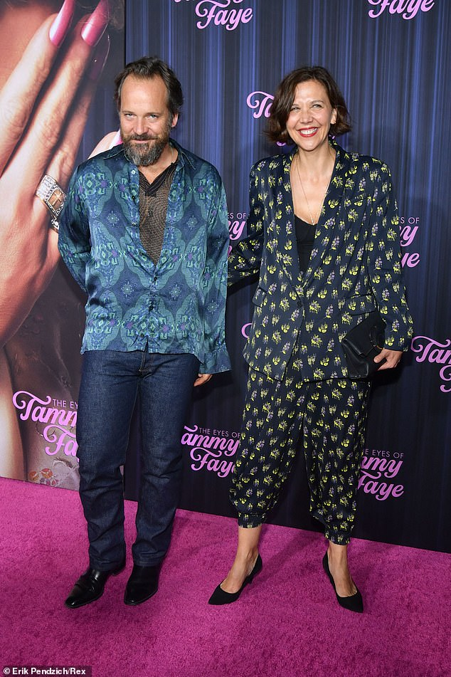 Loved up:Maggie Gyllenhaal put on a loved up display as she arrived to the premiere with her husband of over a decade Peter Sarsgaard