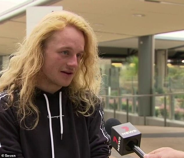 West Australian man Damien (pictured) has admitted the only reason he attempted a dangerous stunt off the side of a train was because 'there's nothing to do in Perth'