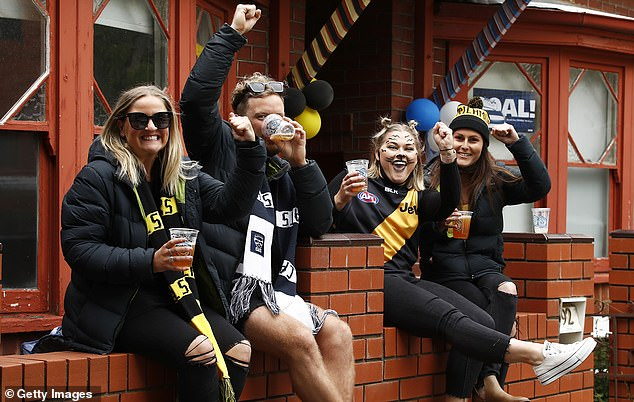 Due to Covid case numbers in Melbourne, the AFL grand final will be played at Perth's Optus Stadium on September 25 (pictured, Richmond fans from last year)