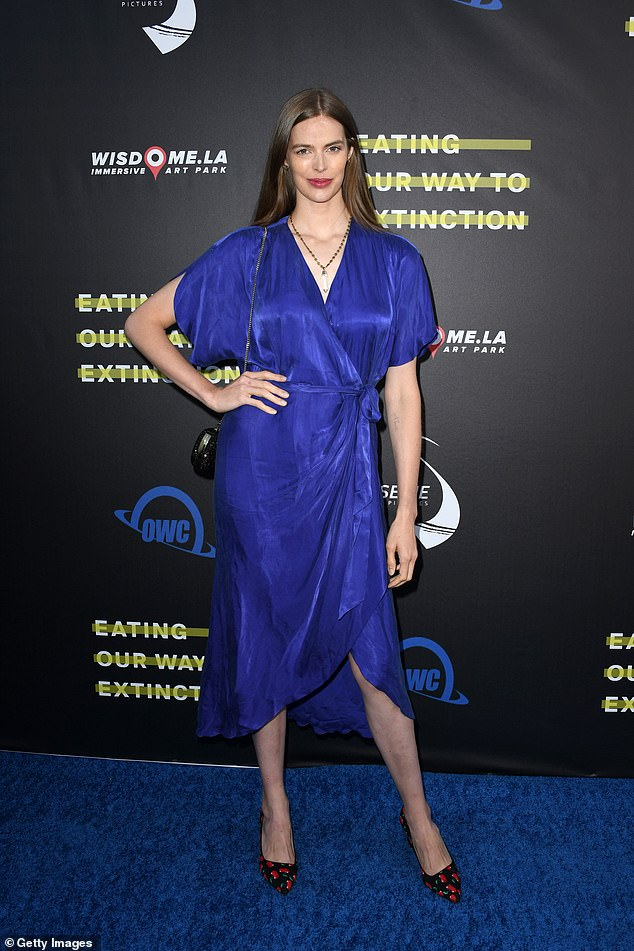 Beauty in blue: Robyn Lawley flaunted her statuesque figure in a vibrant electric blue dress at a film premiere in Los Angeles on Tuesday