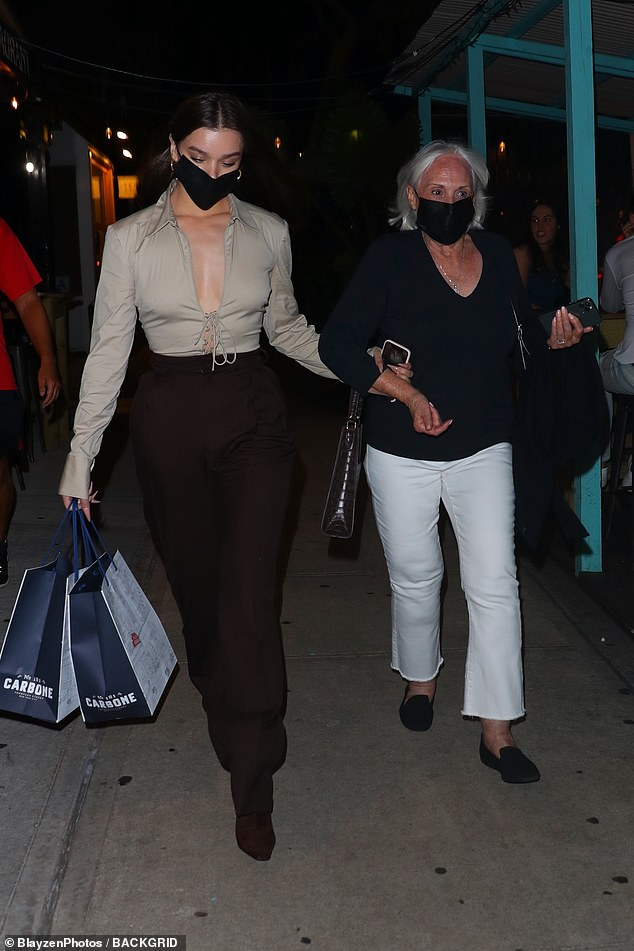 Family oriented:The talented actress later switched up her look to a slightly more demure look as she donned a low-cut grey top with flowy black trousers and black booties to treat her grandmother out to dinner
